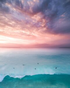 birds eye view of people on beach during sunset